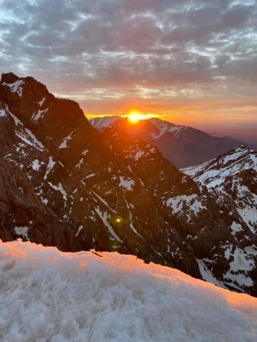 Sunrise from Mount Toubkal, the highest peak in North Africa in the High Atlas Mountain Range - Blog - Dreaming of Benis